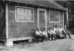 Pictured in front of a cabin at Trout Lake are C. Juday, Eleanor Tressler, Fred Stare, Lowell Taylor, Ed Schneberger, E.A. Birge and Hugo Baum