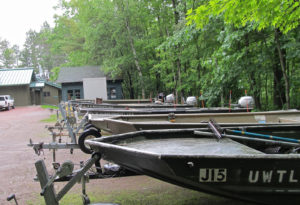 Boat fleet and main station building at Trout Lake Station,