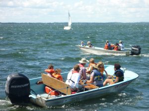 Open House attendees head out on Lake Mendota.