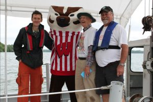 Jake Vander Zanden, Bucky Badger, John Magnuson & Dave Harring on the Limnos at Hasler Lab Open House, 2015  Photo: Marilyn Larsen