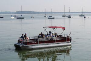 Dave captains the Limnos II on her inaugural voyage with Friends of the Lakeshore Nature Preserve interns.