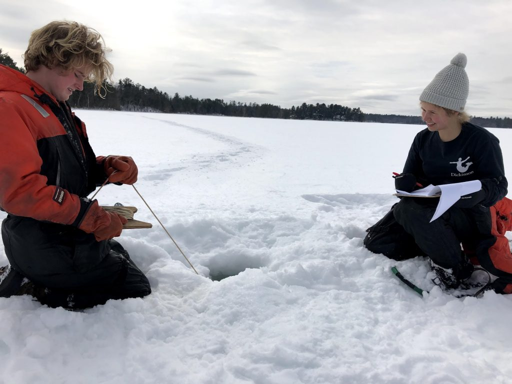 UW-Madison undergraduate, Sam Ahler, and CFL graduate student, Emily Whitaker, take samples through the ice of Sparkling Lake. Photo: Hilary Dugan
