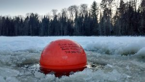 A rare sight in winter, this buoy on South Sparkling Bog marks the location of underwater equipment that records temperature, light, chlorophyll and more. Photo: Paul Schramm
